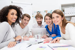 Attractive motivated young business team stock photography