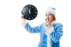 Attractive mrs. Santa with clock Stock Photo