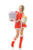 Attractive mrs. Santa with gift boxes Royalty Free Stock Images