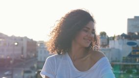 Attractive mulatto young woman with big curly hair dancing and flirting with a viewer - looking in the camera stock video