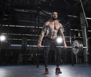 Attractive muscular bodybuilder doing  deadlifts in modern gym.C Stock Image