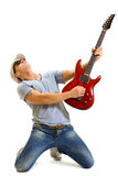 Attractive musician playing guitar Stock Photography
