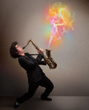 Attractive musician playing on saxophone with colorful abstract Stock Photos