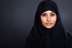 Muslim woman. Attractive Muslim woman on black background stock image