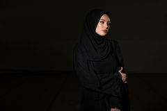 Attractive Muslim Woman On Black Background Stock Images