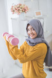 Attractive muslim woman fitness using dumbbell Stock Image