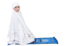 Attractive muslim woman pray - isolated. Attractive female muslim in white dress , isolated on white Royalty Free Stock Image