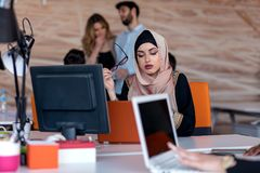 Attractive Muslim young woman working in office on computer. Attractive Muslim young women working in office on computer Royalty Free Stock Photography