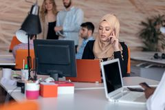 Attractive Muslim young woman working in office on computer. Attractive Muslim young women working in office on computer Stock Images