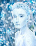 Attractive naked covered in ice woman, cold effect. Attractive naked covered in ice woman with snowy winter forest on background. Sensuality  frosted girl. Snow Royalty Free Stock Photo