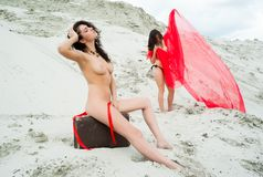 Attractive naked girls on sand Royalty Free Stock Image