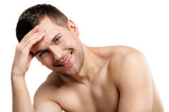 Attractive naked man is evincing his shame royalty free stock photos