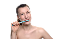 Attractive naked woman brushing her teeth Stock Photos