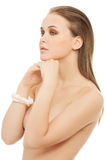 Attractive naked woman with hands close to face. Royalty Free Stock Image
