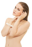 Attractive naked woman with hands close to face. Stock Images