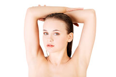 Attractive naked woman with her hands above head. Royalty Free Stock Image