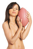 Attractive naked woman holding a ball. Royalty Free Stock Photos