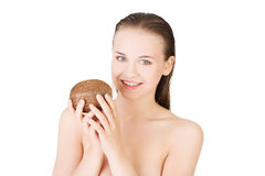 Attractive naked young woman holding a coconut. Stock Image