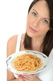 Attractive Natural Happy Young Woman Holding a Plate of Italian Spaghetti Bolognese Stock Photo