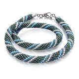 Attractive necklace made of green and blue beads Royalty Free Stock Photo