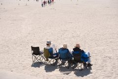 Attractive northwest - older people are resting on the shore of Royalty Free Stock Photo