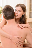 Attractive nude  woman embracing with man Stock Image