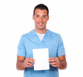 Attractive nurse man holding a blank white card Royalty Free Stock Photo