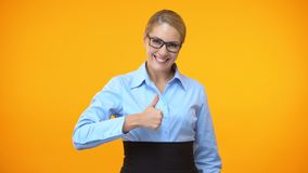 Attractive office manager showing thumbs up, business project approval, idea. Stock footage stock video