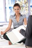Attractive office worker meditating in office Royalty Free Stock Photo