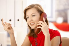 Attractive office worker on phone Royalty Free Stock Photos