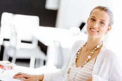 Attractive office worker sitting at desk Stock Photography