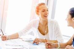 Attractive office worker sitting at desk Royalty Free Stock Photos