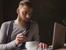 Attractive old-fashioned guy with modern technology Royalty Free Stock Images