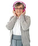 Attractive old lady wearing headphones Royalty Free Stock Photos
