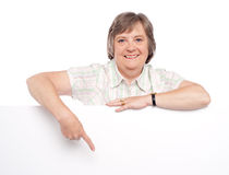 Attractive old woman indicating towards billboard Stock Photography