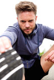 Attractive older athlete outside doing stretch Royalty Free Stock Photography