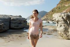 Attractive older female fashion model walking on beach Stock Image