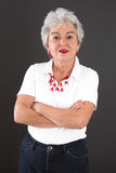Attractive older lady looks questioningly Stock Photography