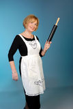Attractive older lady with rolling pin Royalty Free Stock Photography