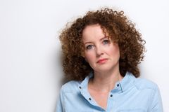 Attractive older woman with curly hair Royalty Free Stock Image