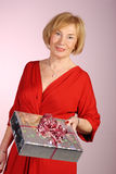 Attractive older woman holding a gift Royalty Free Stock Photos