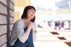 Attractive older woman laughing outdoors Royalty Free Stock Image