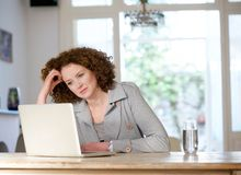 Attractive older woman looking at laptop at home Stock Photography