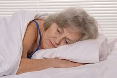 Attractive older woman resting in the bedroom Royalty Free Stock Photos
