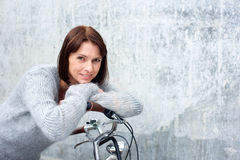 Attractive older woman smiling with bike Royalty Free Stock Images