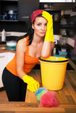 Attractive overworked  woman in kitchen Royalty Free Stock Images
