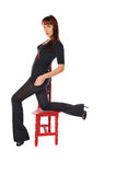 Attractive owman with a red chair Stock Photo