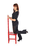 Attractive owman with a red chair Royalty Free Stock Photography