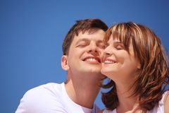 Attractive pair against blue sky Royalty Free Stock Photos