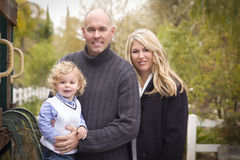 Attractive Parents and Child Portrait in Park Stock Image